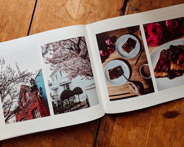 A double page spread showing 2 photos on each page of the photo book.