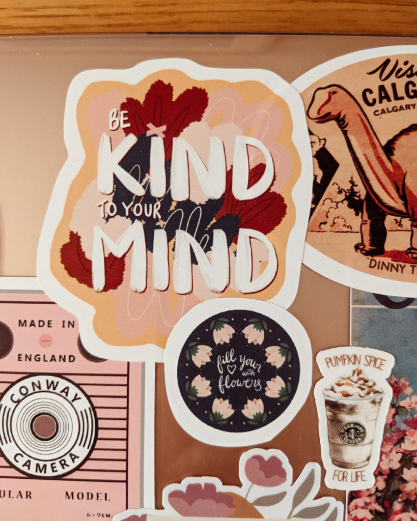 Custom stickers by Pretty Content: Be Kind to Your Mind sticker and small Fill Your Heart with Flowers sticker.